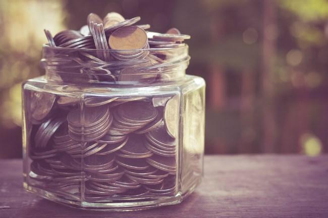 Kids saving jar full of coins