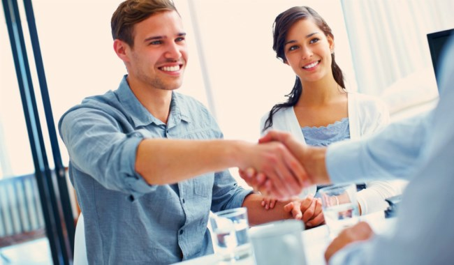 Shaking hands with someone over the counter after viewing a home for sale