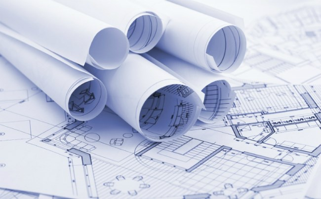 planning permission documents for a home extension rolled up