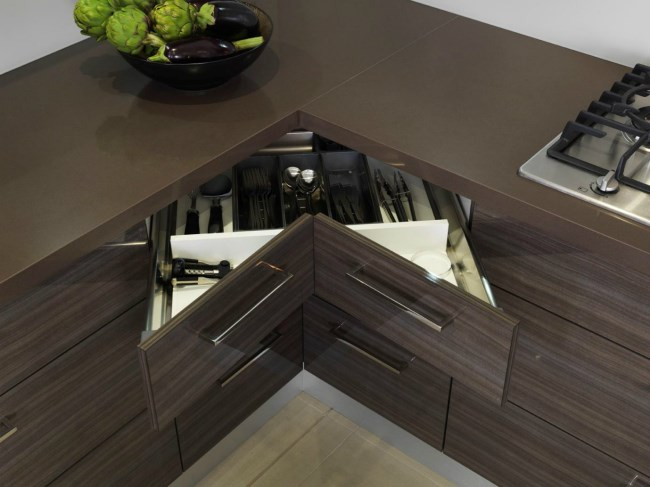 V-shaped pull out drawers in a small kitchen