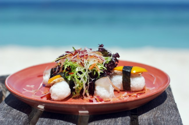 plate of sushi with a sea view