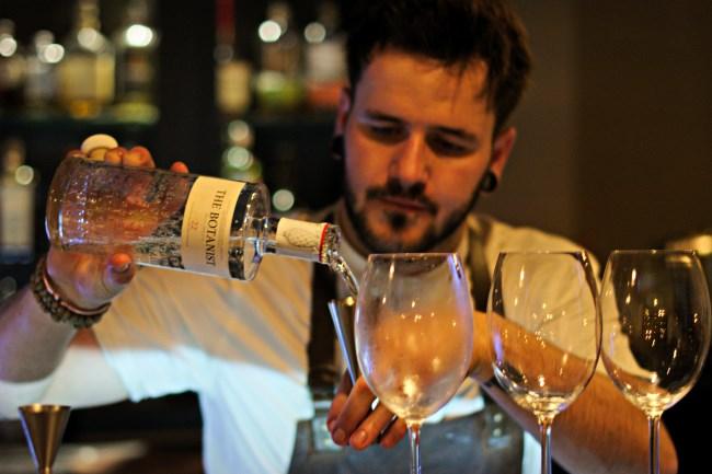 barman pouring drink at bar