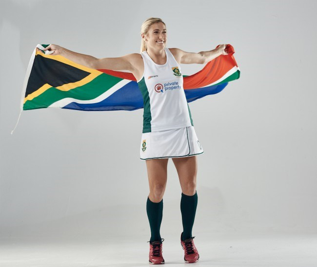 Image of hockey player holding the south african flag