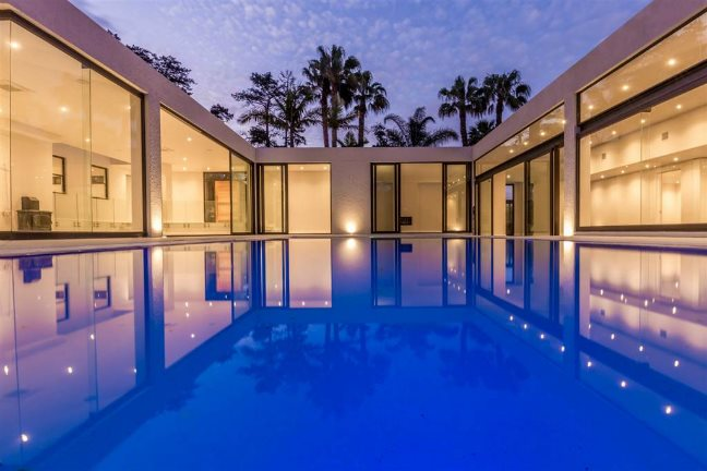 ![Swimming pool and house
